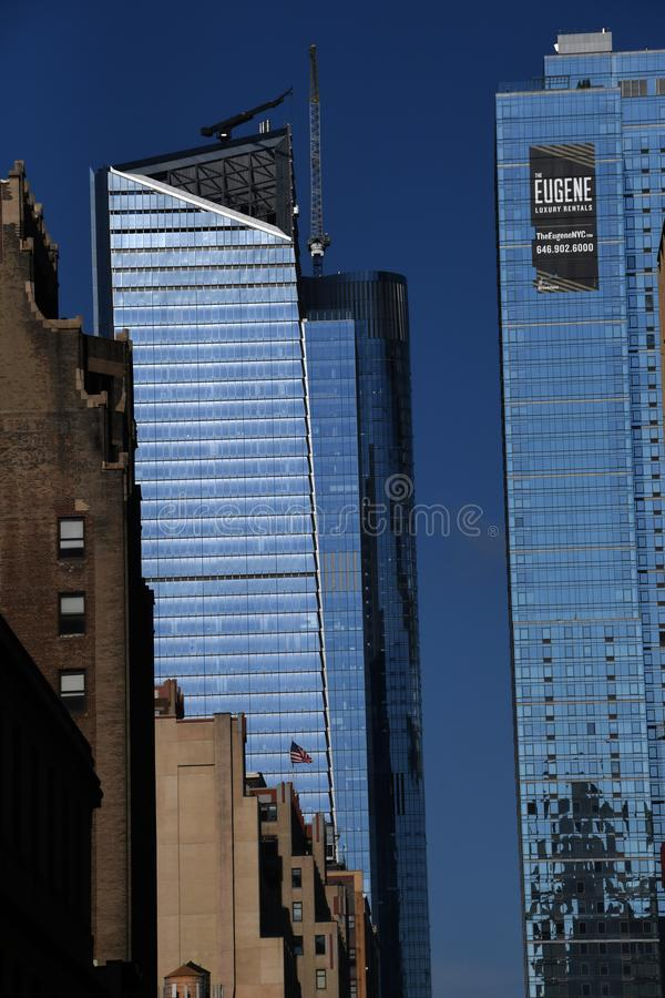 New York City skyscraper in Midtown Manhattan. On a sunny day with trees and a blue sky royalty free stock photo