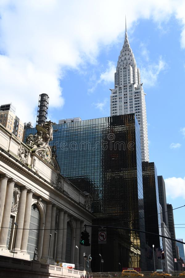 New York City skyscraper in Midtown Manhattan. On a sunny day with trees and a blue sky royalty free stock photography