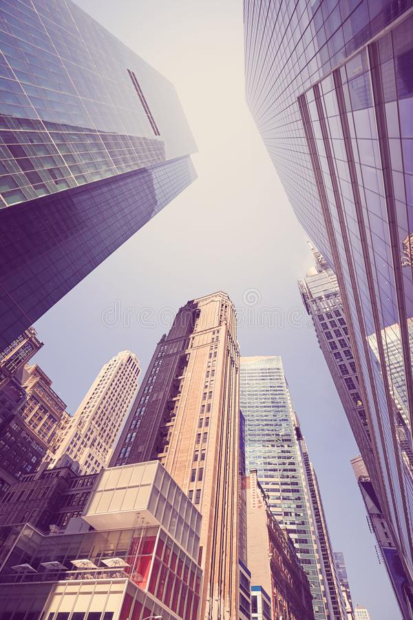 New York City skyscrapers, looking up perspective. New York City skyscrapers, looking up perspective, color toned picture, USA stock photo