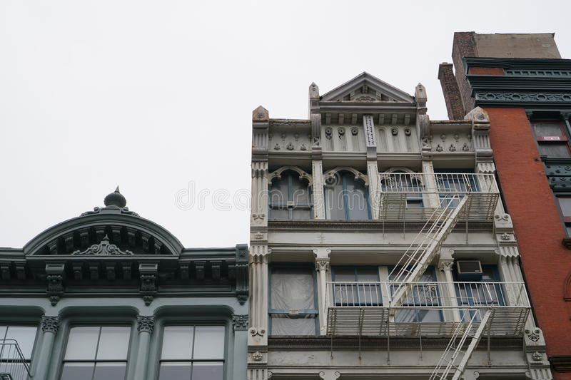 New York City SOHO building facades with fire escape stairs royalty free stock image
