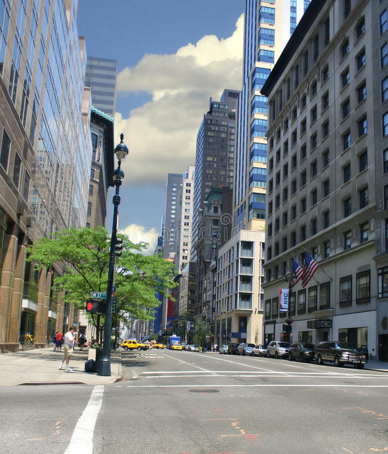 New York City Street. Typical new york street filled with cabs and modern buildings royalty free stock images