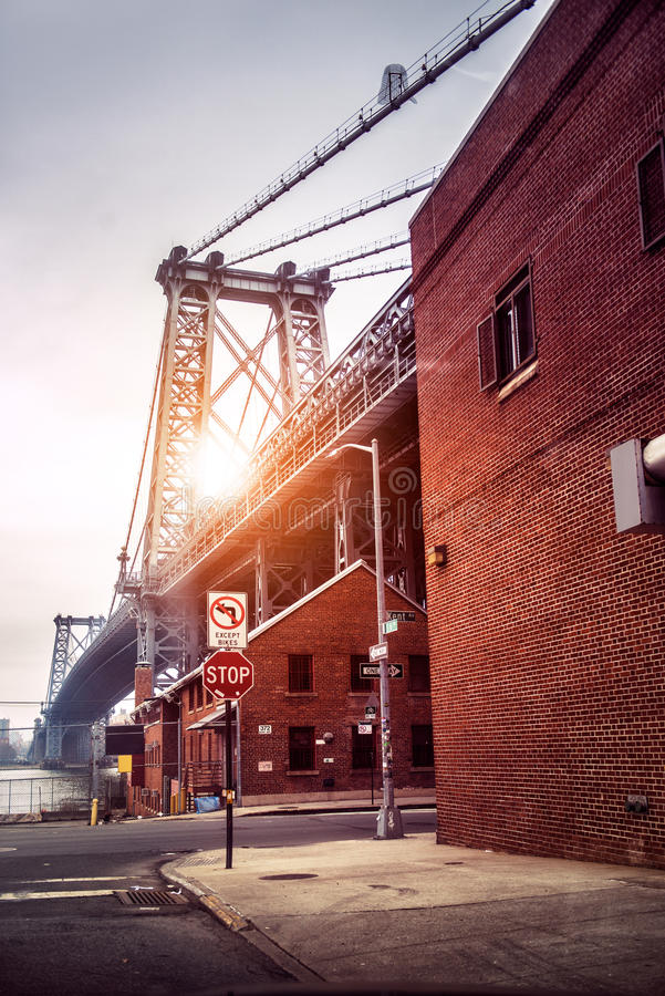 New York City street in Brooklyn with view to Williamsburg Bridge at sunset time stock photography