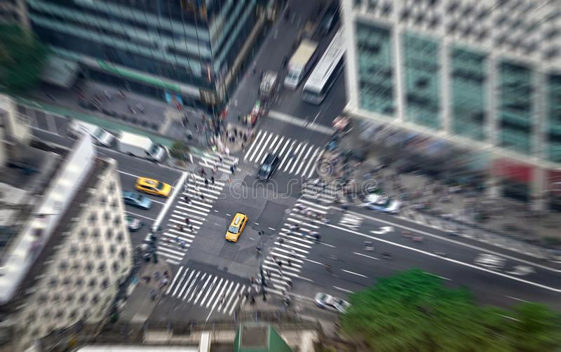 New York city street full of taxis, cars and pedestrians. Yellow cab in focus. Busy NYC Downtown. royalty free stock image