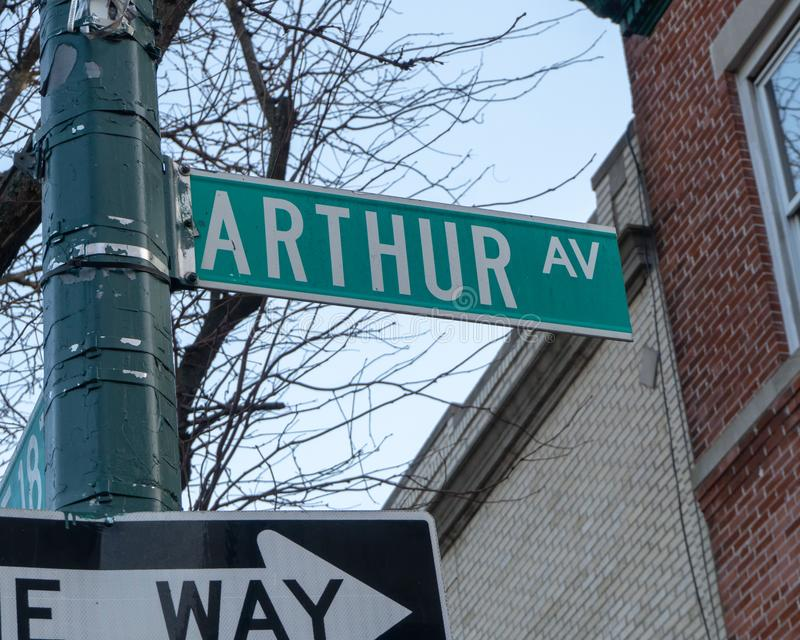 New York City Street Sign for Arthur Avenue. A closeup of the NYC street sign for Arthur Ave, the Bronx`s Little Italy stock photography