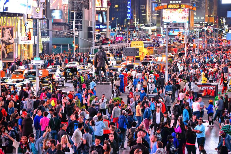 NEW YORK CITY Times Square ,is a busy tourist intersection of neon art and commerce and is an iconic street full of pe stock images