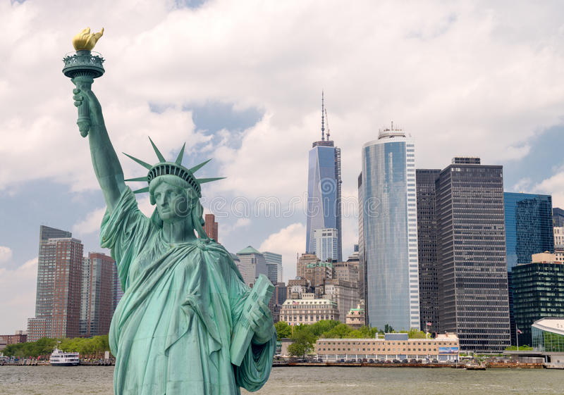New York City tourism concept. Statue of Liberty with Lower Manhattan skyline royalty free stock photo