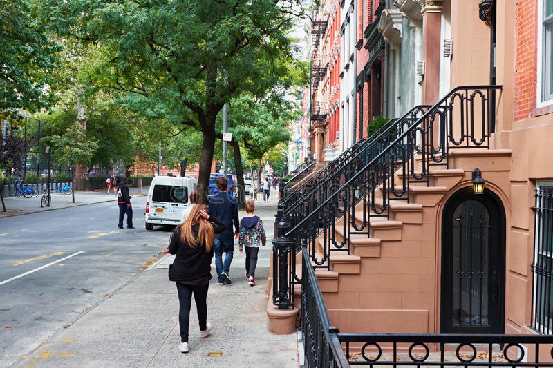 New York City townhouses. NEW YORK CITY - OCTOBER 10, 2014: nyc townhouses with stairs to the pavement in E 190th Street, East Village royalty free stock image