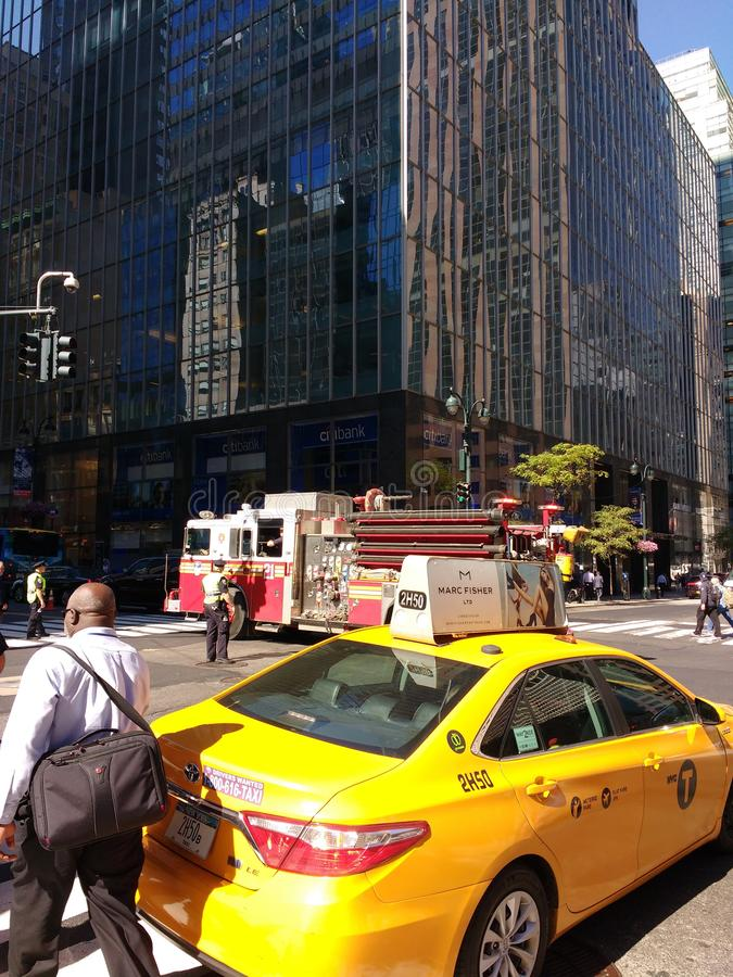 New York City Traffic at 42nd Street, Midtown, Manhattan, NYC, NY, USA. New York City at the corner of East 42nd Street and Madison Avenue. In this one snapshot stock image