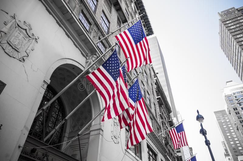 New York City, United States. Multiple American flags waving from the facade of a building royalty free stock photos