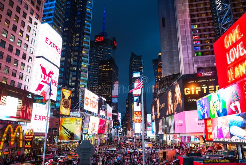 New York City, United States - November 3, 2017: Crowds gather in Times Square at twilight in the evening. Tourist intersection stock photography