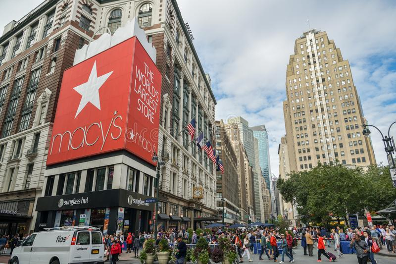 Crowd of people walking on Herald Square in front of one of the largest deparment stores in the world - Macy`s. New York City, United States - October 5, 2018 royalty free stock photo