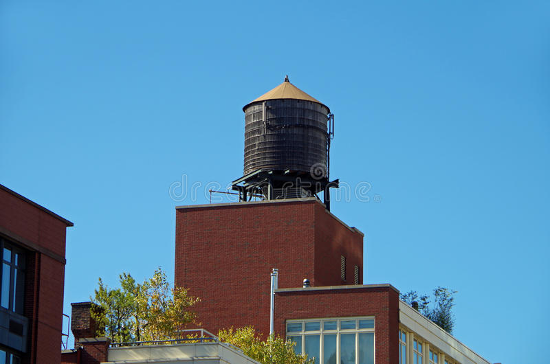 New York City urban water towers. And rooftops stock image