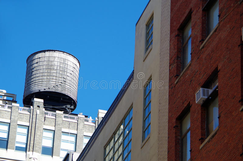 New York City urban water towers. And rooftops stock images