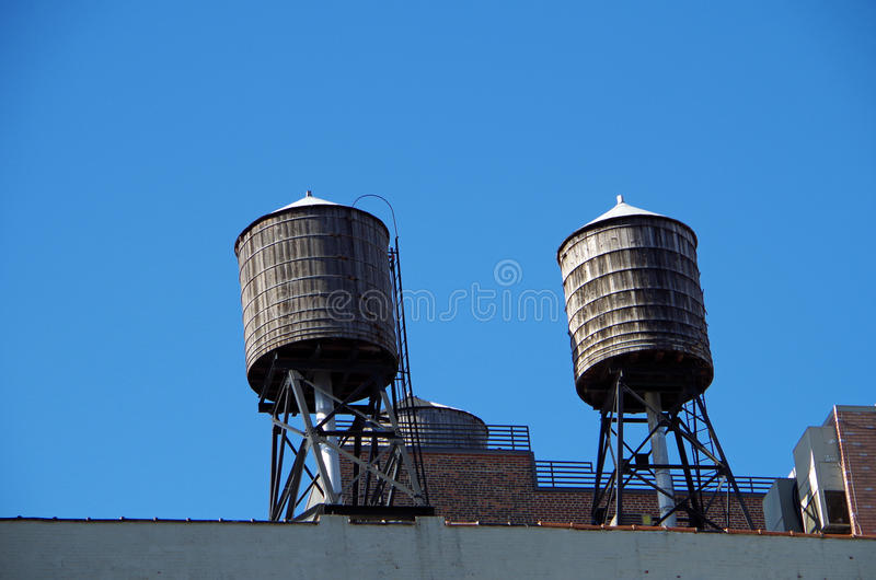 New York City urban water towers and rooftops. New York City urban water towers stock photo