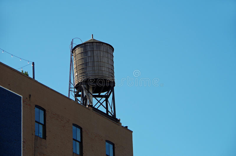 New York City urban water towers. And rooftops stock photography