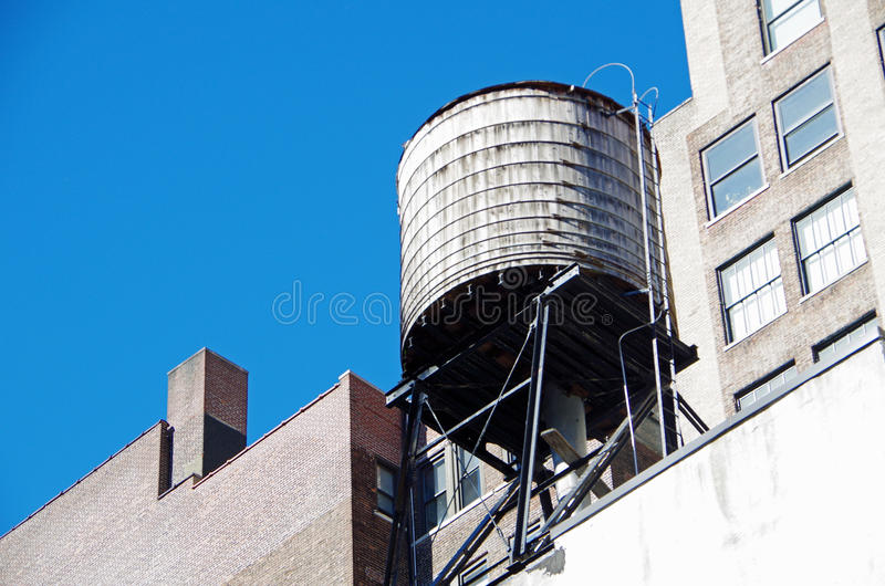 New York City urban water towers and rooftops. New York City urban water towers royalty free stock photos