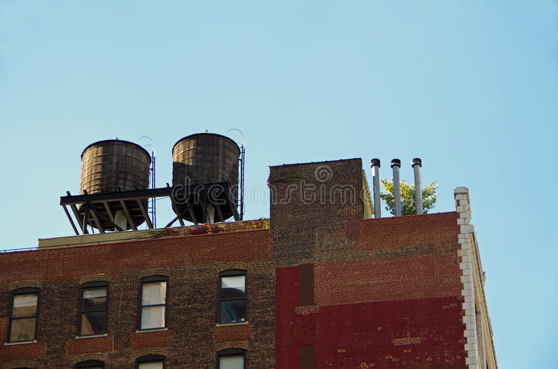 New York City urban water towers and rooftops. New York water towers and rooftops royalty free stock photography