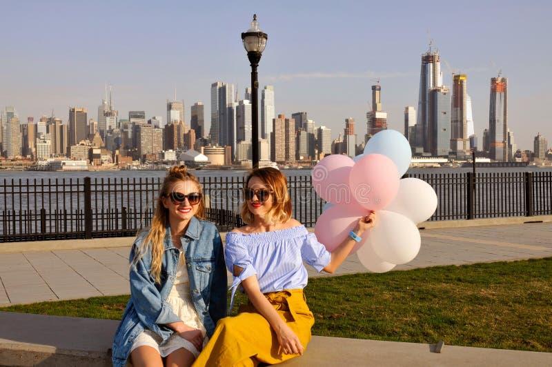 New York city urban women enjoying view of downtown Manhattan skyline, summer travel in USA royalty free stock images