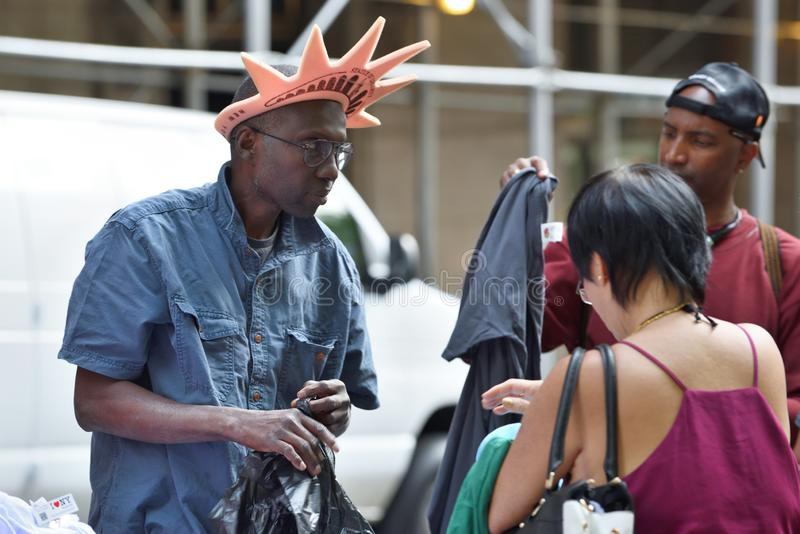 People trade souvenirs in Manhattan royalty free stock photo