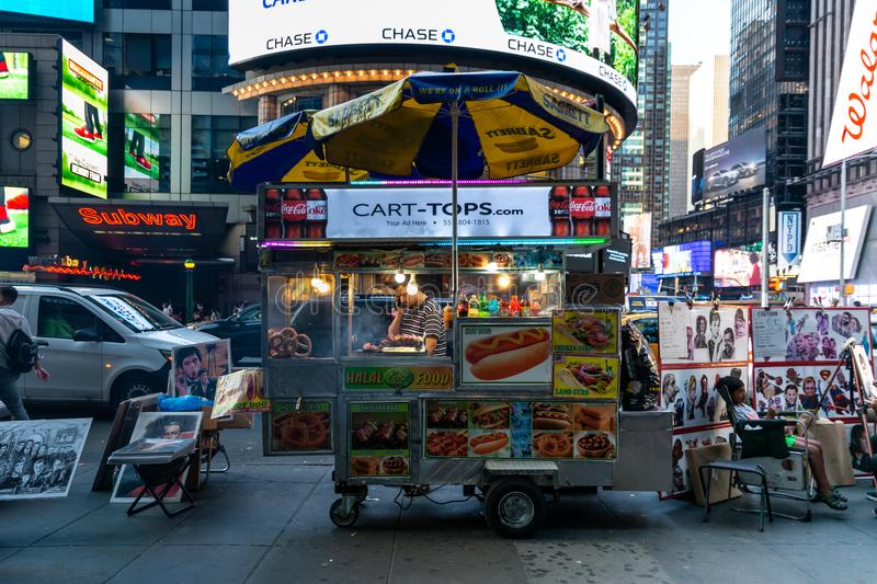 New York City / USA - JUL 13 2018: Times Square street food cart royalty free stock images