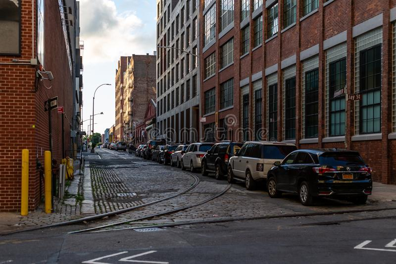 New York City / USA - JUN 25 2018: Quiet street in Dumbo Brooklyn at early morning sunrise stock photo