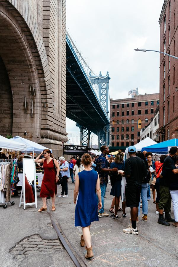 Brooklyn Flea Market in DUMBO in New York. New York City, USA - June 24, 2018: Brooklyn Flea Market in DUMBO. It includes vendors of furniture,collectibles and stock photography