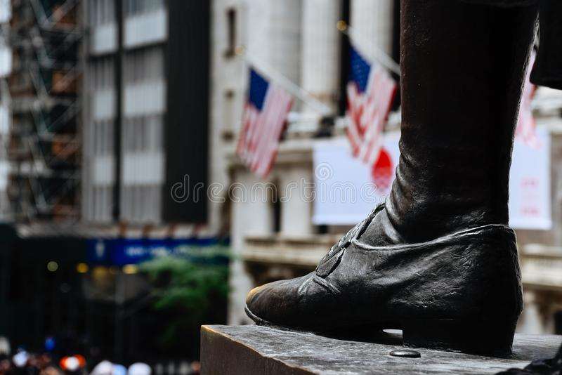 Close up of foot of George Washington statue in Federal Hall in stock photo
