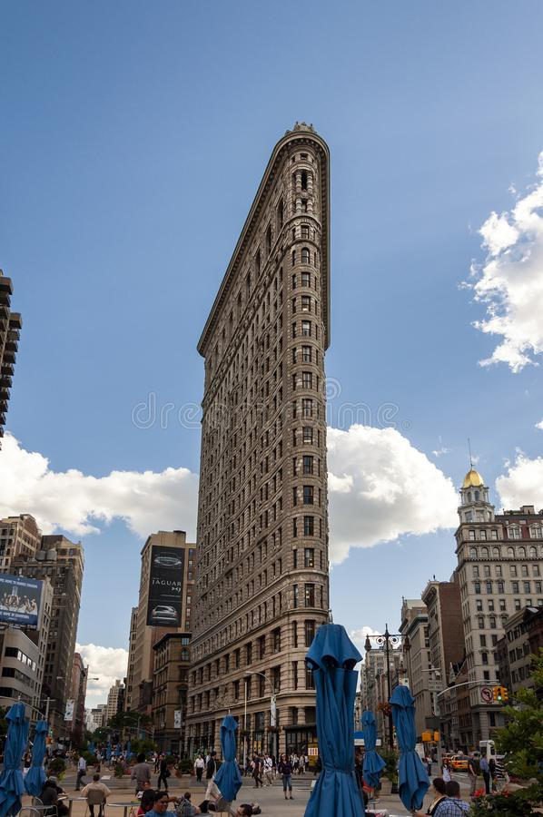 Street scene with people and the Flatiron Building in New York City royalty free stock images