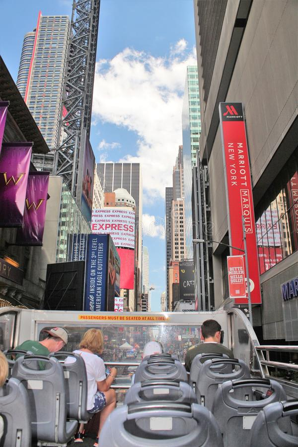 New York City, USA, June 19, 2017 tourists sightseeing in N Y on an open air bus - editorial use only. New York City, USA, June 19, 2017 tourists sightseeing in royalty free stock images