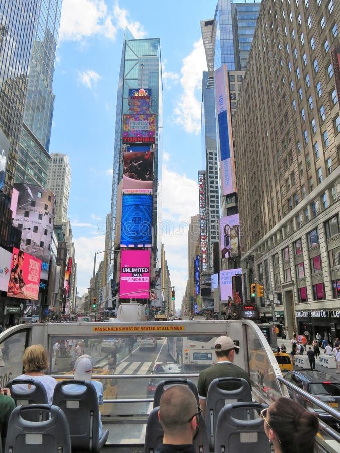 New York City, USA, June 19, 2017 tourists sightseeing in NY on an open air bus. New York City, USA, June 19, 2017 tourists sightseeing in N Y on an open air bus royalty free stock photography