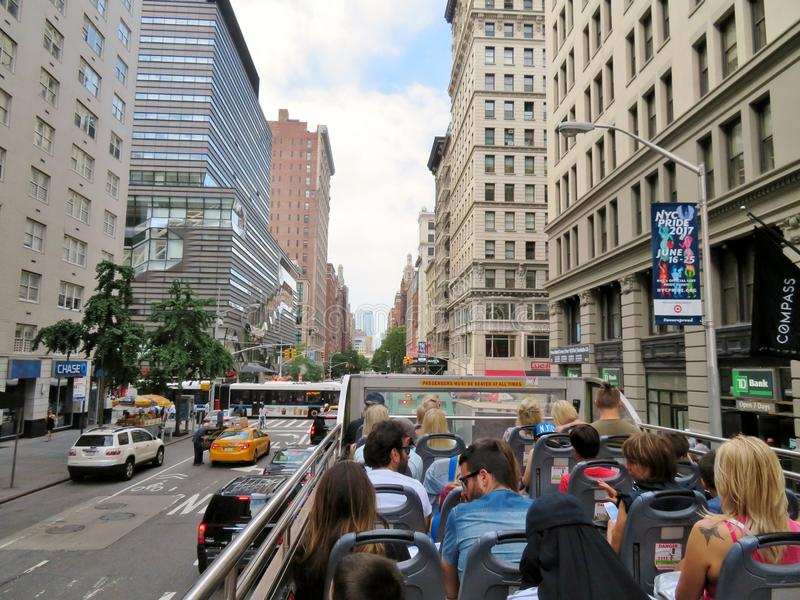 New York City, USA, June 19, 2017 tourists sightseeing in NY on an open air bus. New York City, USA, June 19, 2017 tourists sightseeing in N Y on an open air bus stock photography