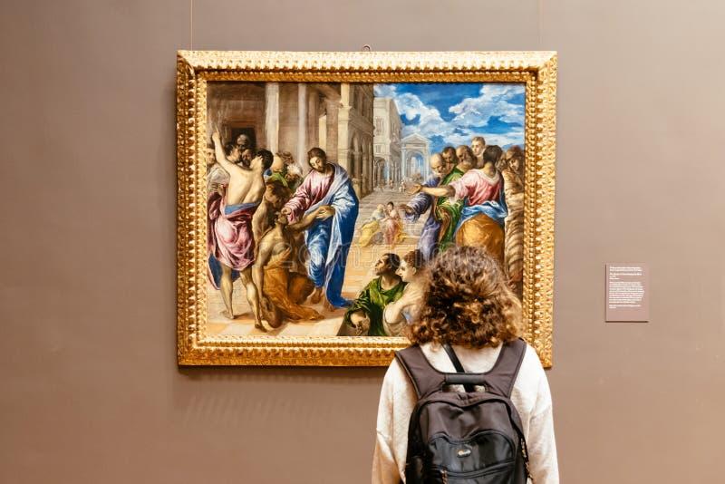 Woman looking at painting at Metropolitan Museum of Art. New York City, USA - June 23, 2018: Woman looking at painting at Metropolitan Museum of Art. The MET is stock photo