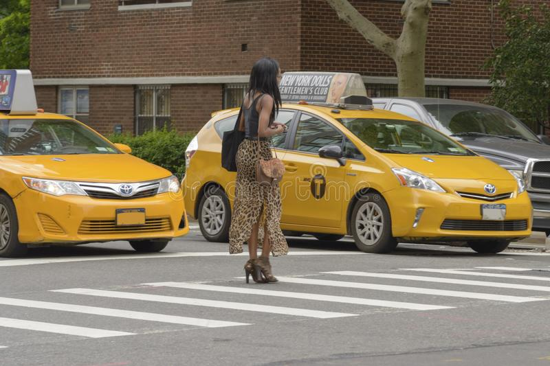The American woman crosses the pedestrian crossing while the tax royalty free stock photography
