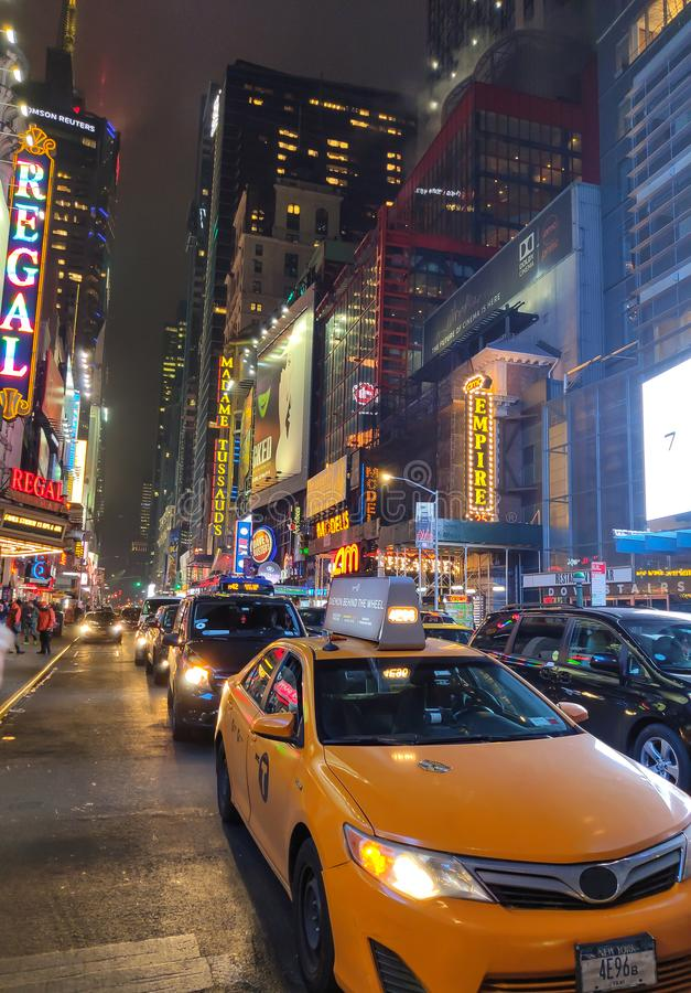 New York City at night. 42nd Street traffic and neon signs stock images