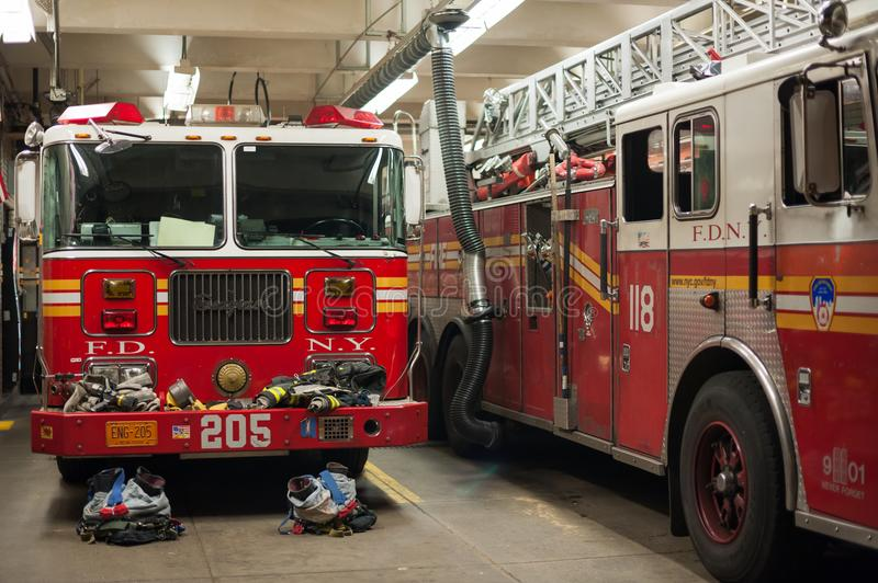 New York Fire Department trucks in a fire station royalty free stock photo