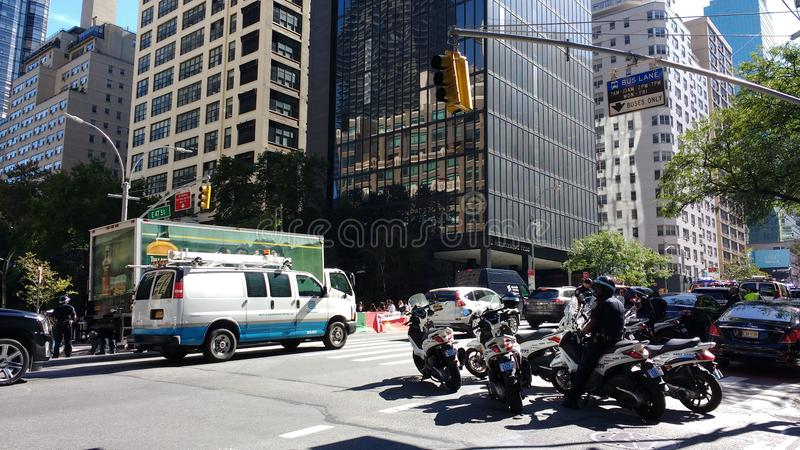 Police Scooters, NYC, NY, USA. New York City, USA, September 22nd 2017: A rally for the liberation of Southern Cameroons/Ambazonia is taking place at the corner royalty free stock image