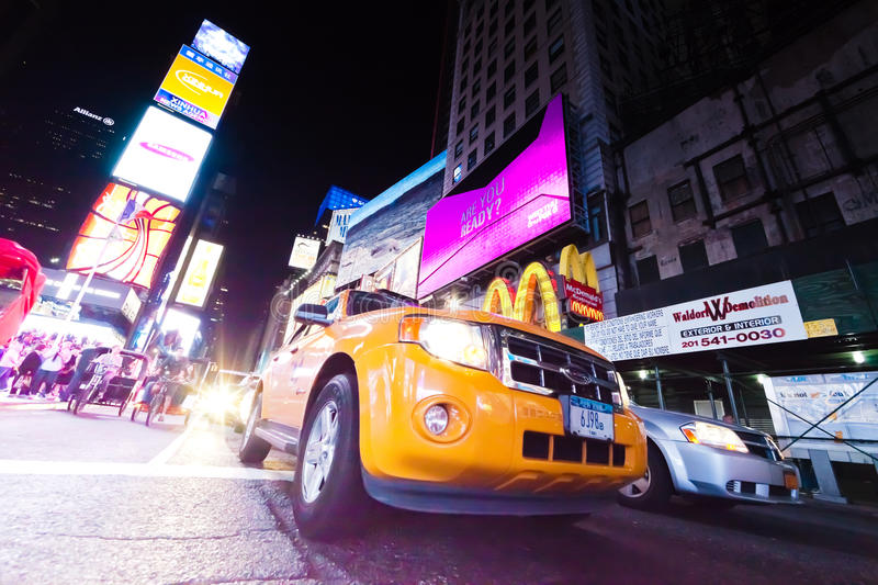 NEW YORK CITY, USA - Times Square. NEW YORK CITY, USA-SEPTEMBER 21: Times Square, featured with Broadway Theaters, Taxi Cabs, Luxury Limousines and animated LED royalty free stock image
