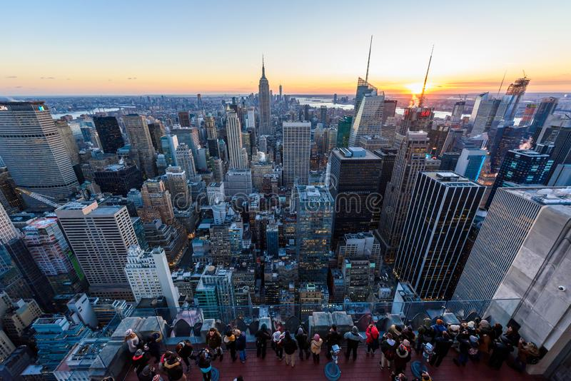 New York City - USA. View to Lower Manhattan downtown skyline with famous Empire State Building and skyscrapers at sunset royalty free stock images