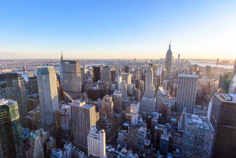 New York City - USA. View to Lower Manhattan downtown skyline with famous Empire State Building and skyscrapers at sunset royalty free stock photo