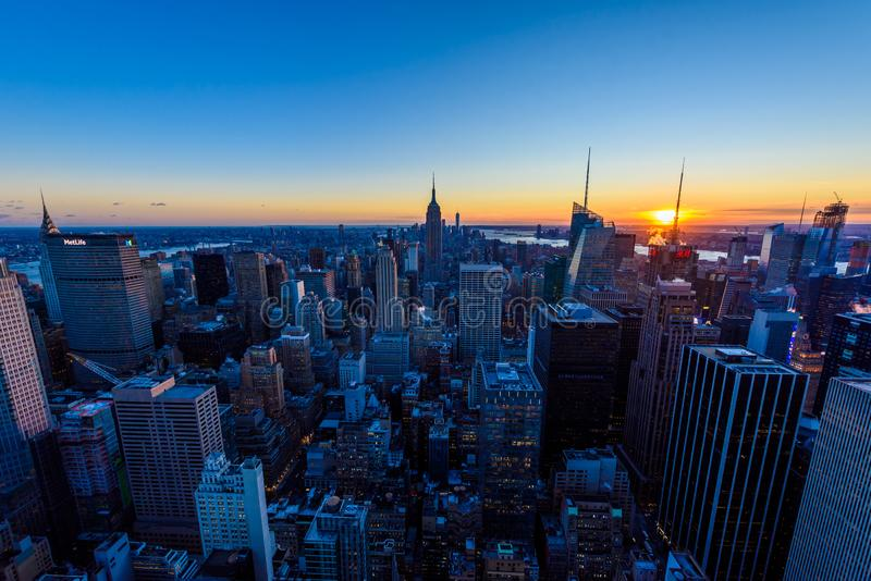New York City - USA. View to Lower Manhattan downtown skyline with famous Empire State Building and skyscrapers at sunset royalty free stock photography