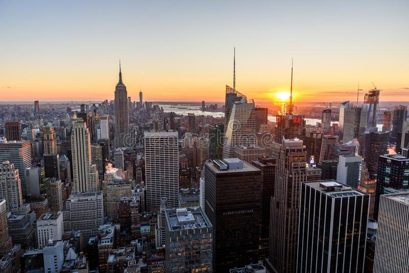 New York City - USA. View to Lower Manhattan downtown skyline with famous Empire State Building and skyscrapers at sunset stock photo