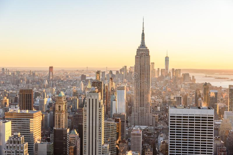 New York City - USA. View to Lower Manhattan downtown skyline with famous Empire State Building and skyscrapers at sunset. stock photos