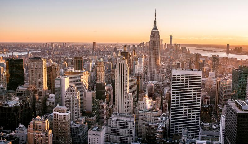 New York City - USA. View to Lower Manhattan downtown skyline with famous Empire State Building and skyscrapers at sunset. Travel destination in United States stock photo