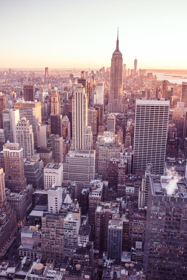 New York City - USA. View to Lower Manhattan downtown skyline with famous Empire State Building and skyscrapers at sunset. royalty free stock photography