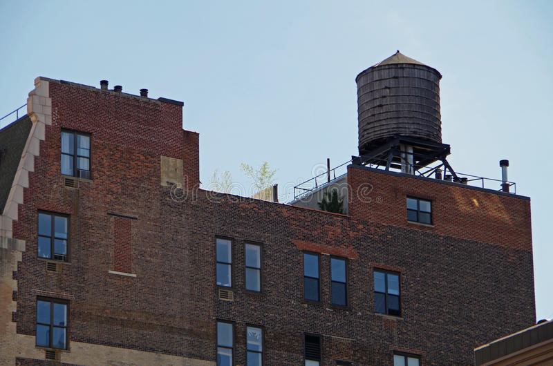 New York City water tower. On top of brick apartment building stock images