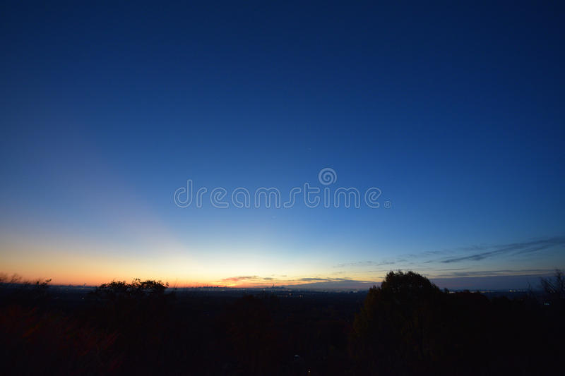 New York City, NYC wide view. Crescent moon crescent Venus. Shows Manhattan, Bronx, NYC New York City, and Newark and suburbs in New Jersey. Shows Moon and Venus royalty free stock image
