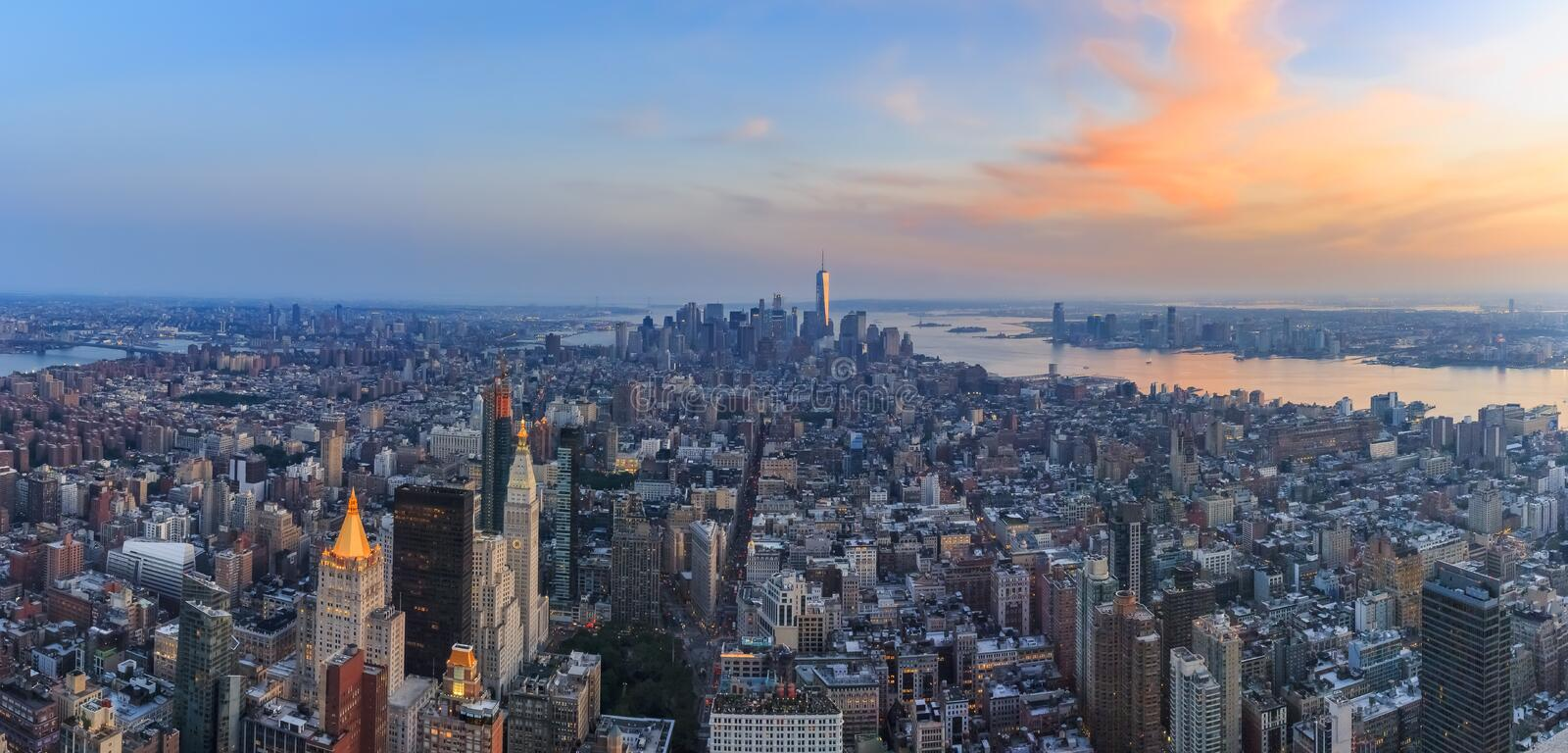 New York Downtown and lower Manhattan skyline view with the One World Trade Center skyscraper at sunset. New York , USA - May 31, 2016: Aerial sunset view of stock photography