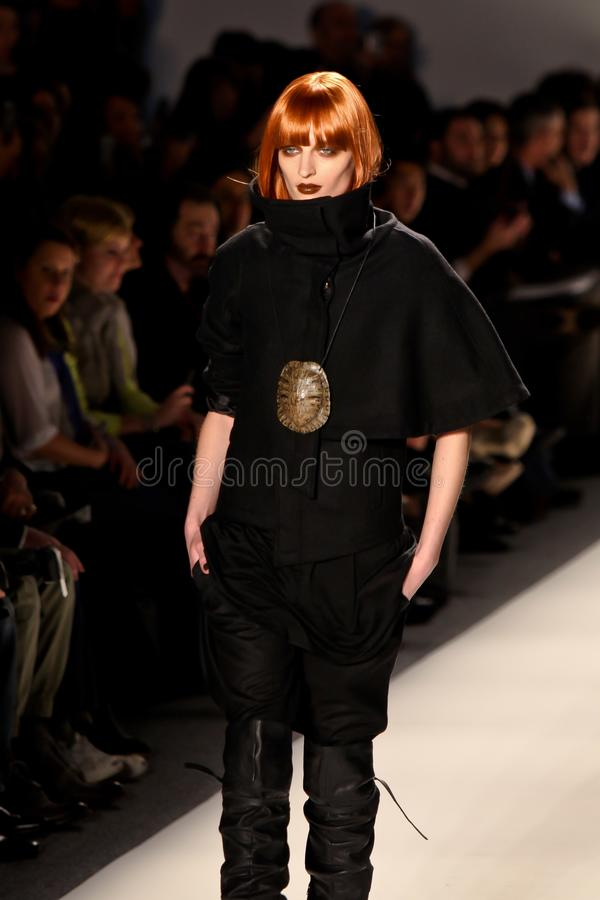 Model walks the runway for the Nicholas K collections stock photography