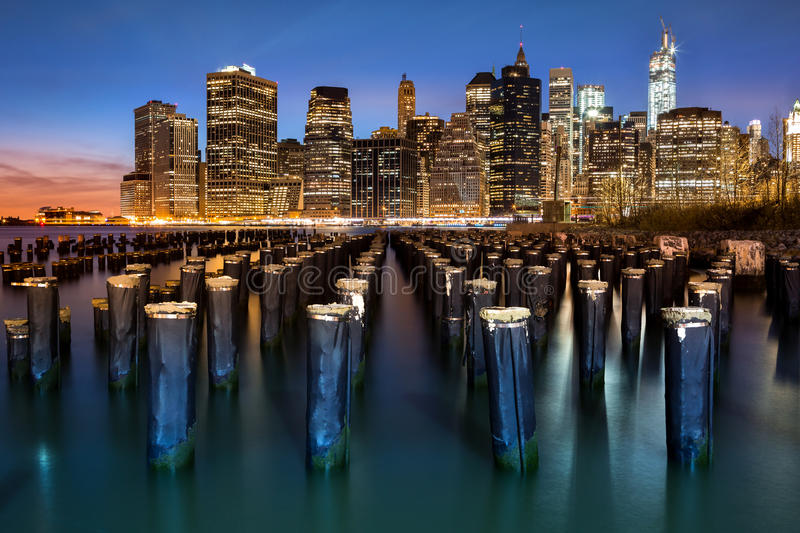 New York Financial District. With Freedom Tower still under construction and an old Brooklyn pier royalty free stock image