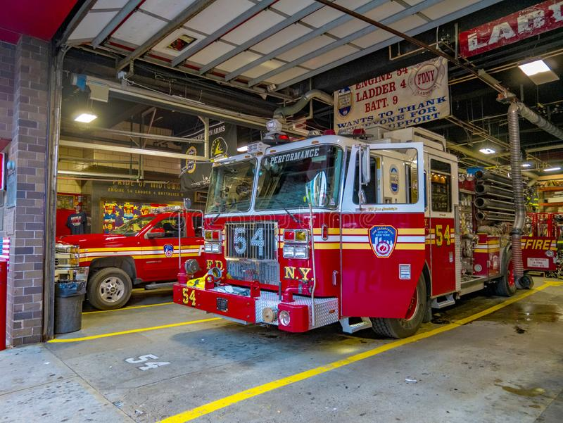 New York fire brigade vehicles in red color. Manhattan. United States of America. Organized body of people fireman trained and employed to extinguish fires stock image